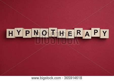 Wooden Blocks With Word Hypnotherapy On Red Background, Flat Lay