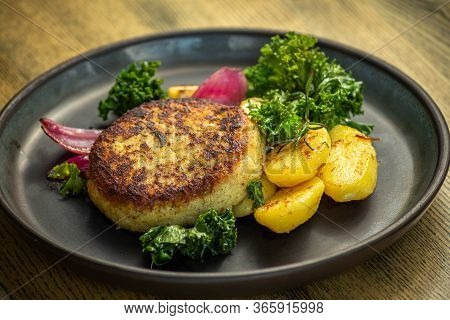 Cooked Cod Fish Cutlet With Potatoes, Lettuce