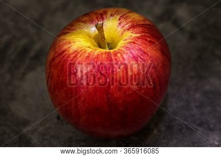 Juicy Fresh Red Apple With Water Droplets On A Dark Background With Space For Text