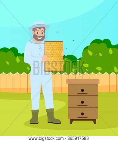 Bearded Beekeeper Wearing Protection Suit Hold A Honeycombs Standing At The Bee-garden Near Hive Wit