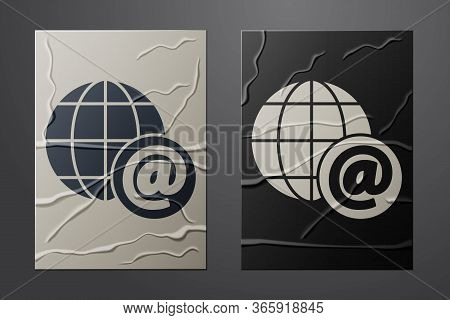 White Earth Globe With Mail And E-mail Icon Isolated On Crumpled Paper Background. Envelope Symbol E