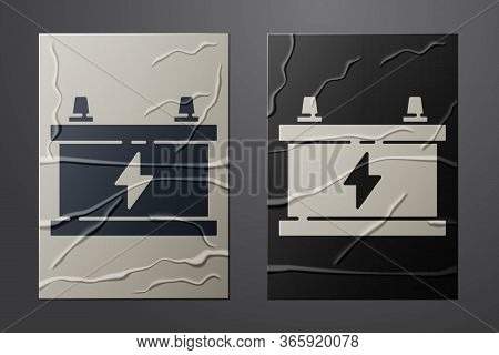 White Car Battery Icon Isolated On Crumpled Paper Background. Accumulator Battery Energy Power And E