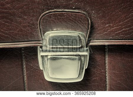 Metal Buckle Or Clasp On An Old Scratched Leather Suitcase
