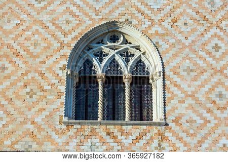 Ornate semicircular window. Decor element. Magical journey to magnificent Venice. Doge's Palace is a great monument of Italian Gothic architecture. The concept of cultural and photo tourism