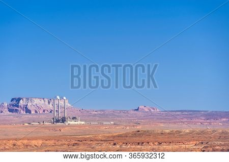 Power plant Generating Station Electricity with colorado river and lake powell landscape generating in Navajo Page Arizona United States. USA Landmark environmental and electricity concept.