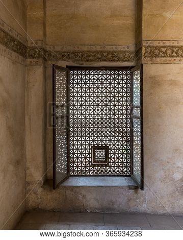 Vintage Window With Wooden Arabesque Ornaments - Mashrabiya - Located Inside Empty Room With Grunge
