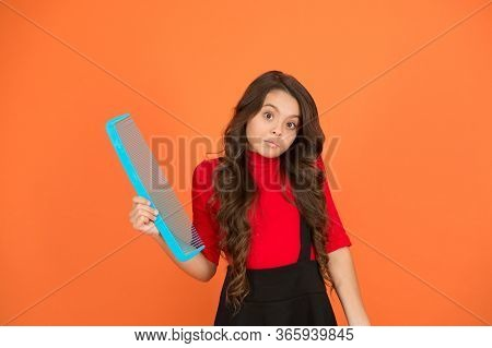 It Can Be Easy To Haircare. Small Girl Hold Comb Brown Background. Haircare Tool. Hair Untangling. B