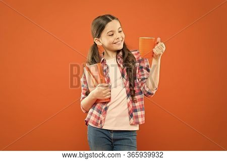 Spend Nice Time With Favorite Book. Girl Hold Cup Of Tea And Book. Literature For Kids. Enjoy Spendi