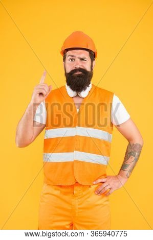 Construction Idea. Builder Point Finger Up Yellow Background. Working Man Got Idea. Building Idea An