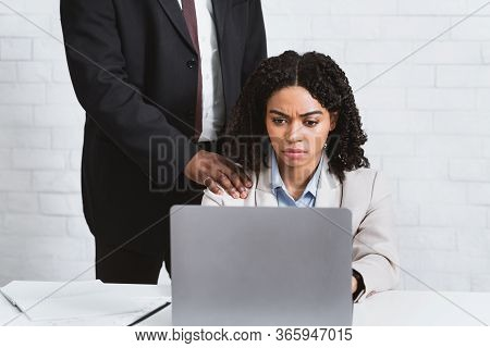 Sexual Molestation At Workplace. Beautiful African American Girl Being Harassed By Her Boss At Offic