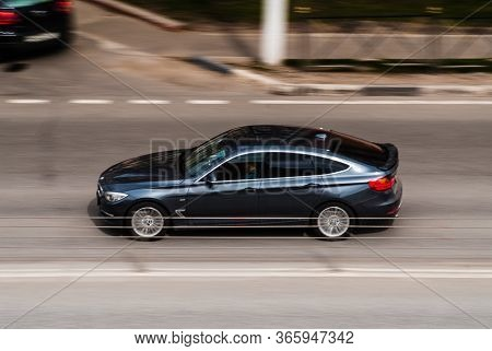 Moscow , Russia - April 30, 2020: Dark Gray Bmw Gt Car On The City Road. Fast Moving Vehicle On Mosc