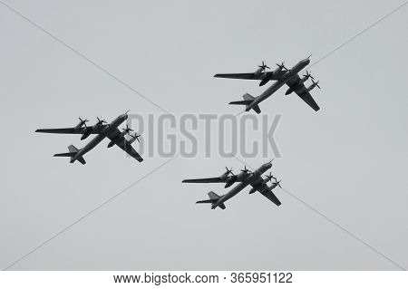Moscow, Russia - May 9, 2020:a Group Of Turboprop Strategic Bombers Tu-95ms Fly Over Red Square In A