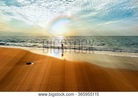 A Girl Looks Into The Rainbow Sun Rays With A Spirit Of Wonder And Awe