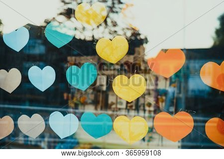 Close Up Hand Made Paper Hearts In Rainbow Colors And Form On The Window Showcase. The Symbol For Su