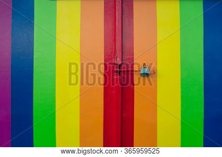 Colorful Rainbow Stripy Door In Lgbt Flag Colors With A Padlock. Love Diversity Under A Ban, Prohibi