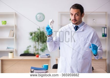 Young male doctor virologist in the office