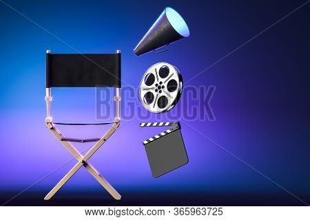 Loudspeaker, Director Chair Film Reel And Movie Clapper On Blue Neon Background. Online Movie Concep