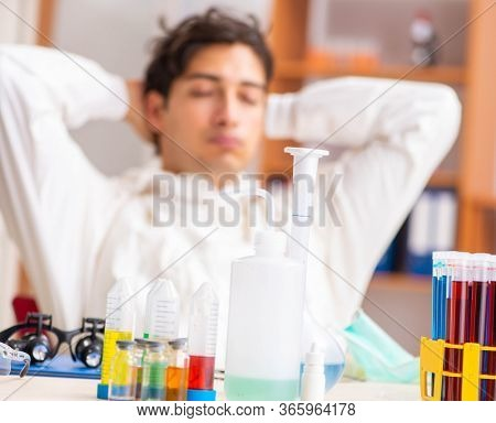 Young biochemist wearing protective suit working in the lab