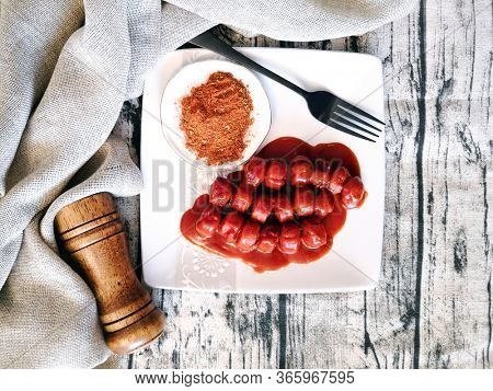 Tasty german sausage served with sauce