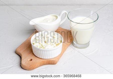Homemade Fermented Beverage In A Glass Of Kefir, Cottage Cheese, Sour Cream On A White Background, C