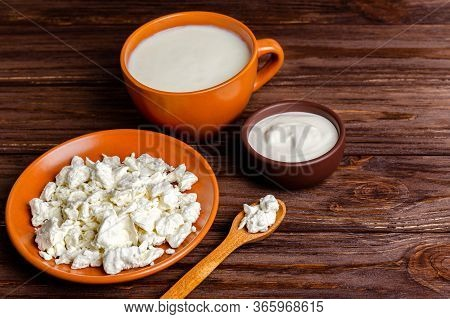 Homemade Dairy Products - Kefir, Cottage Cheese, Sour Cream On A Wooden Background, Copy Space, Flat