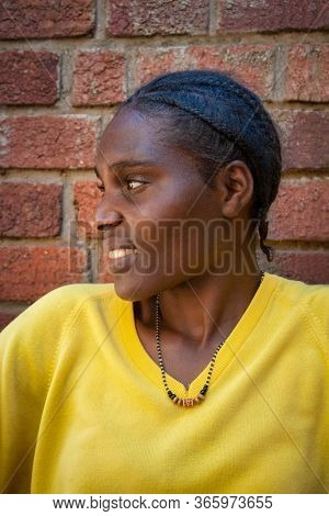 young African woman with braids portrait