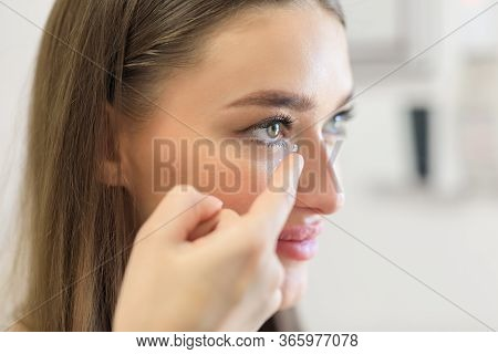Contact Lens For Vision Concept. Close Up Side View Portrait Of Smiling Girl Applying Eye Lens