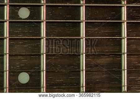 Closeup Vintage Guitar Fretboard And The Rust String Is A Part Of The Guitar. Concept Of Good Memory