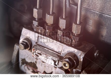 Closeup Of An Old Slightly Rusty Carburetor. High Pressure Fuel Pump. Metal Connections With Wire An