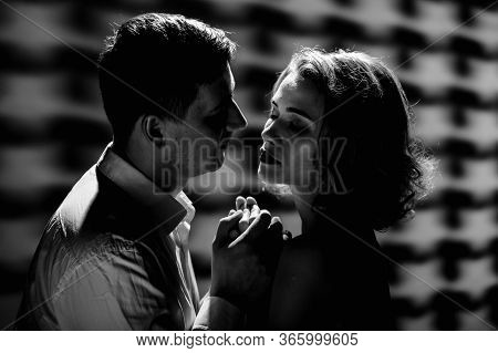 Two Passionate Romantic Lovers Embracing And Going To Kiss