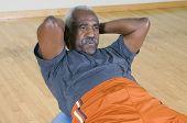 Senior man doing sit-ups on a pilates ball poster