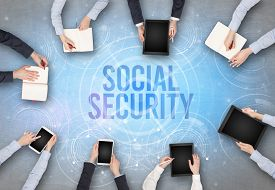 Group of people in front of a laptop with SOCIAL SECURITY insciption, web security concept