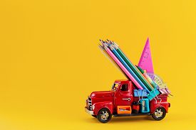 Back To School Sale Background. Car Delivering School Stationery On Yellow Background. Composition W