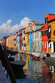 Street With Colorful Houses, Canal ,boats And Reflections. Burano, Venice, Italy.