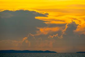 Sunset Orange Cloud Back On Dark Silhouette Sky And Ship On Sea