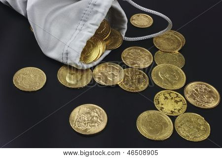 Close up of gold coins on the black  background