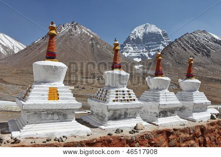 Buddhistic stupas (chorten) in Tibet and holy Mount Kailash on background
