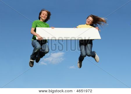 Kids With Blank Sign Jumping