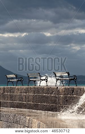 Benches With A Dark Sky With Rays Of Sunshine