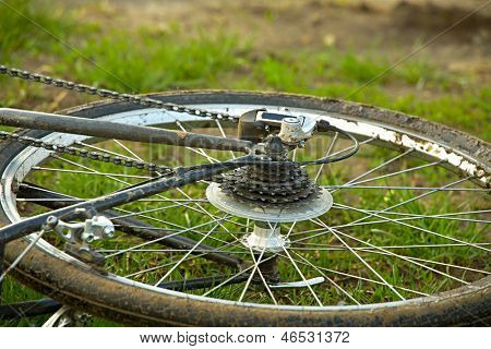 Dirty bicycle on a field