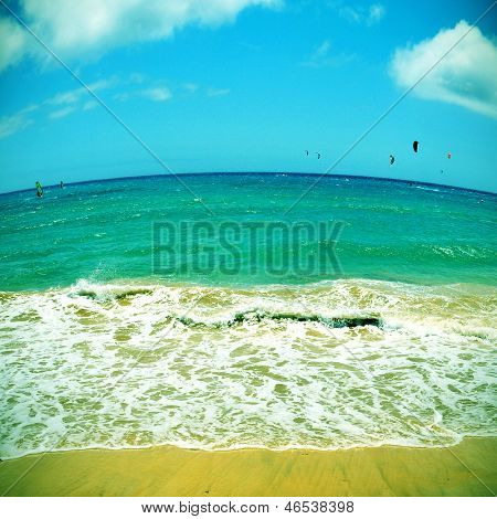 picture of kitesurfers and windsurfers in Sotavento Beach in Fuerteventura, Canary Islands, Spain, with a fisheye lens effect