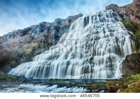 Dynjandi is the most famous waterfall of the West Fjords and one of the most beautiful waterfalls in the whole Iceland. It is actually the cascade of waterfalls poster
