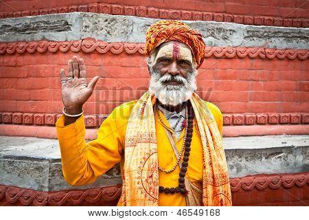 KATHMANDU, NEPAL - MAY 18: Shaiva sadhu seeks alms on the Pashupatinath Temple  on May 18, 2013 in Kathmandu, Nepal