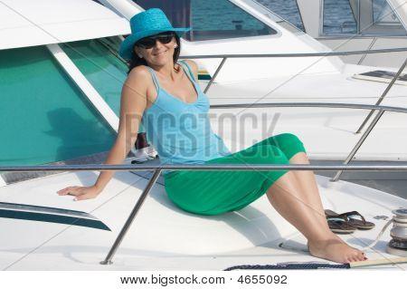Beautiful Woman Aboard A Yacht Sunbathing