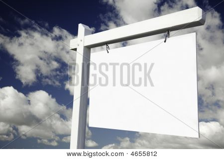 Blank Real Estate Sign On Cloudy Sky