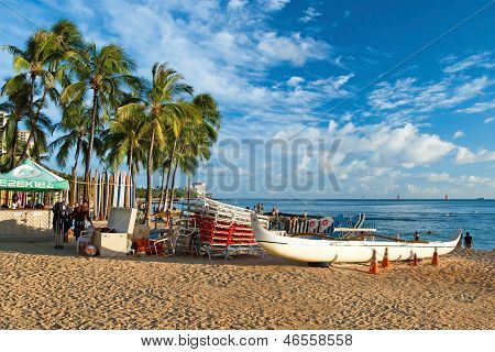 Waikiki Beach With A Surfs And Azure Water In Hawaii