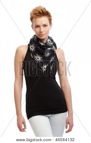 Young attractive gingerish woman in black top and scarf standing over white background.