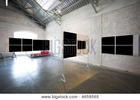 Four empty black large banners on exposition poster