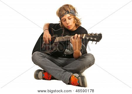 Rocker teen with bandana playing accoustic guitar isolated on white background poster