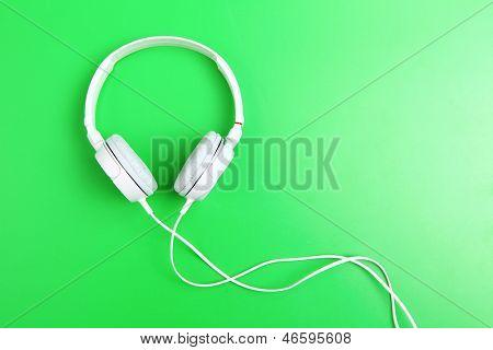 Headphone on green background